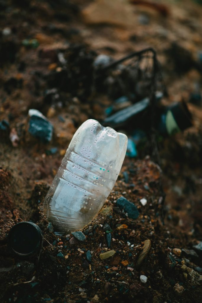 ISG Investigators fly tipping bottle on beach